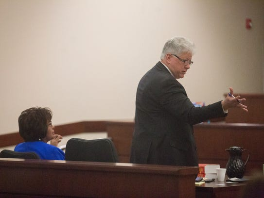 State Rep. Sharon Clahchischilliage, left, listens as her lawyer Gary Risley speaks Friday in Aztec District Court.