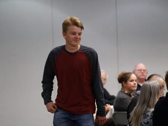 Youth winner Dylan Olsen is recognized on Thursday during the annual volunteer awards and service learning reception at San Juan College in Farmington.