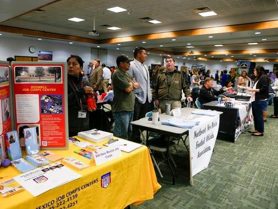 Local companies and organizations participate in a community job fair Friday at San Juan College in Farmington.