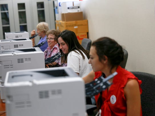 Election clerks gather information from voters Tuesday at the San Juan County Office of Emergency Management building in Aztec.