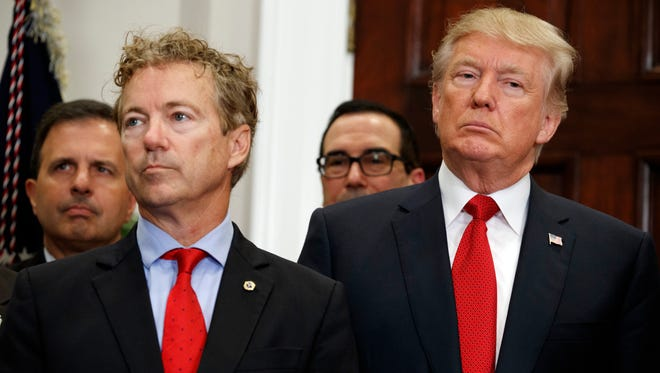President Donald Trump stands with Sen. Rand Paul, R-Ky., during an event to sign an executive order on health care in the Roosevelt Room of the White House, Thursday, Oct. 12, 2017, in Washington.