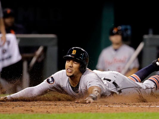 Detroit Tigers' Dixon Machado slides home to score on a three-run double hit by Nicholas Castellanos during the fifth inning of a baseball game against the Kansas City Royals, Thursday, Sept. 28, 2017, in Kansas City, Mo. (AP Photo/Charlie Riedel)