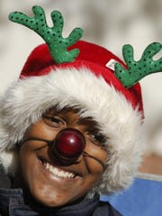 Victor Avery of Jackson gets into the spirit during last year's Jackson Christmas Parade.
