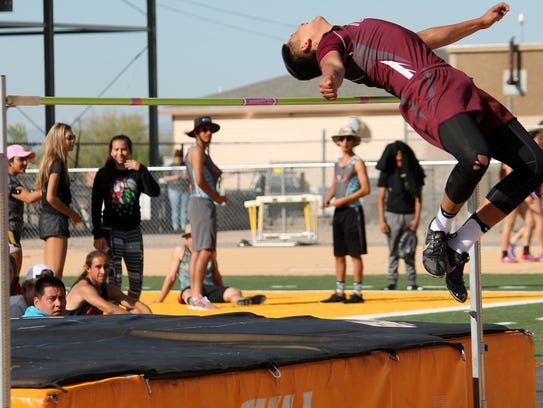 Tularosa's Joe Perez jumps over the horizontal bar