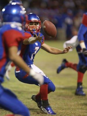 Indio quarterback Fernando Meza pitches the ball against Coachella, Friday, November 6, 2015.