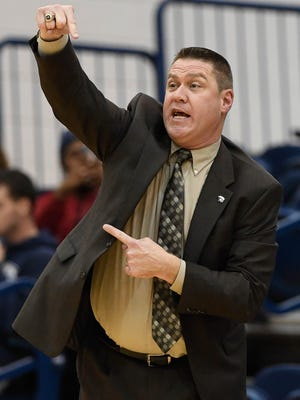 University of Southern Indiana's head coach Rick Stein signals his team as the USI women play the Kentucky State Thorobreds at the PAC arena Wednesday, December 7, 2016.