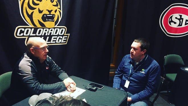 St. Cloud State men's hockey coach Bob Moztko (left) talks with Duluth News-Tribune reporter Matt Wellens during NCHC Media Day at Xcel Energy Center in St. Paul.