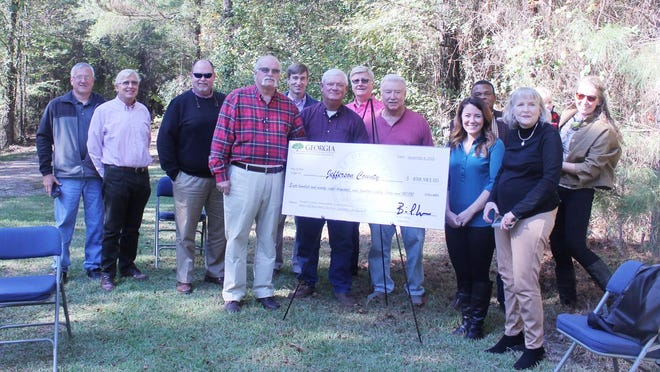 Jefferson County Commissioners and other officials stand with the grant check for $898,983 from the DNR to help create the Ogeechee Crossing Park during the groundbreaking ceremony Wednesday, Nov. 4.