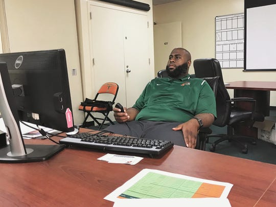 Alex Jackson spends several hours looking over footage in preparation for the season. The offensive coordinator has a new vision for FAMU's playbook for 2018.