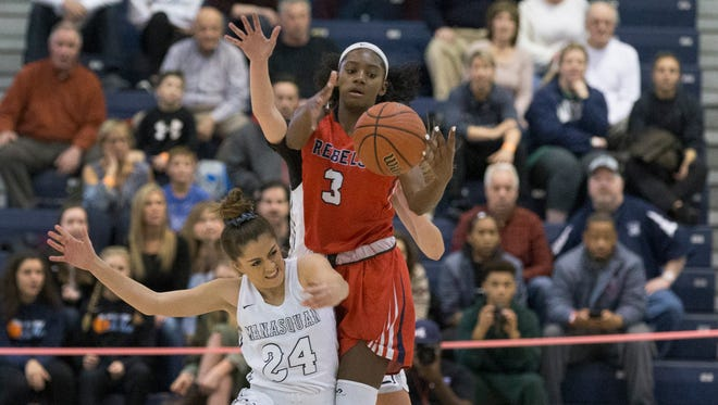 Saddle River Day's Jaida Patrick (3) steals the ball as she battles with Manasquan's Annie Mako. Manasquan Girls Basketball vs Saddle River Day in NJSIAA Tournament of Champions semifinal game at Toms River on March 16, 2018.