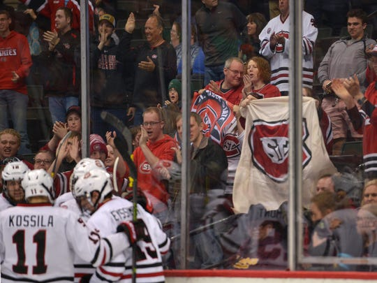 St. Cloud State teammates and supporters celebrate Jacob Benson's goal during the third period of the NCAA Division 1 West Regional semifinal game Saturday, March 25, at the Xcel Energy Center in St. Paul. Ferris State's 5-4 victory over St. Cloud State in overtime ends the Huskies' run for title.