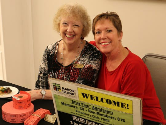 Cathy Mendygraw and Donna Niemczyk check in the guests for the event.