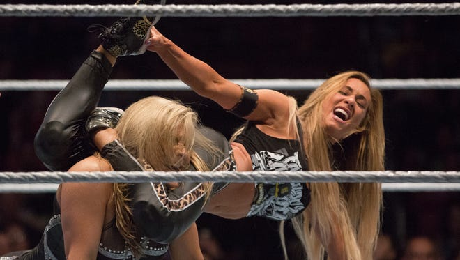 """WWE contestant Carmella, right, performs a """"Code of Silence"""" move against Natalya Neidhart at the Pan American Center in 2017."""