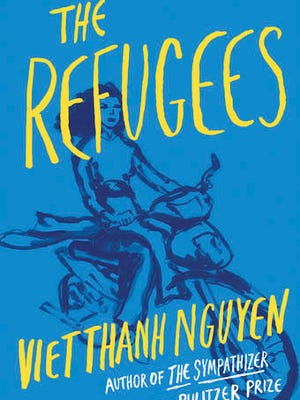 "This cover image released by Grove Press shows ""The Refugees,"" by Viet Thanh Nguyen."