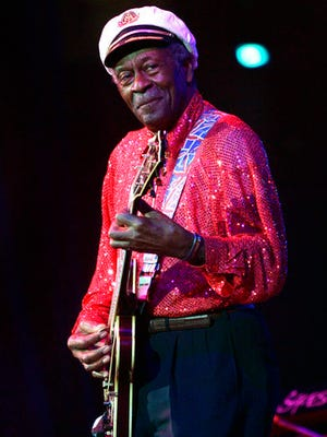 FILE - In this Saturday, May 30, 2009 file photo, Chuck Berry performs at The Domino Effect, a tribute concert to New Orleans rock and roll musician Fats Domino, at the New Orleans Arena in New Orleans. On Saturday, March 18, 2017, police in Missouri said Berry has died at the age of 90.