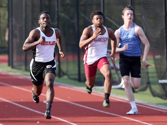 From left, White Plains' Elizah Gorden on his way to