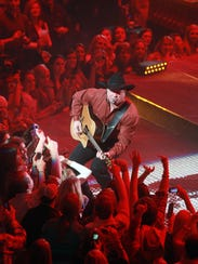 Garth Brooks is performing for a packed house in his