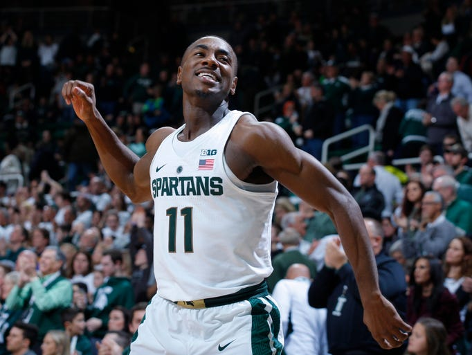 Michigan State's Tum Tum Nairn celebrates the team's