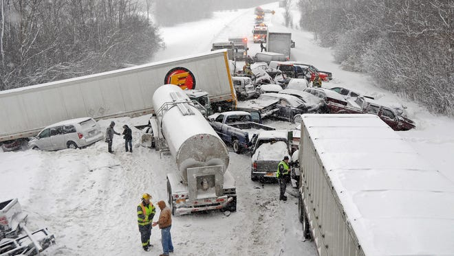 Cars and tracker trailers are tangled up after a huge pileup along Interstate 81, Friday, Feb. 6, 2015, near Sandy Creek, N.Y.