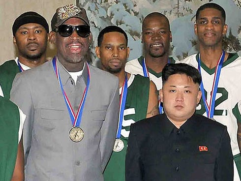 This photo taken on Jan. 8, 2014, and released by North Korea's official Korean Central News Agency (KCNA), shows North Korean leader Kim Jong-Un (front R) photographed with former U.S. basketball star Dennis Rodman.