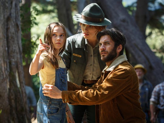 """Natalie (Oona Laurence) talks to her father (Wes Bentley) and Grace (Bryce Dallas Howard) in """"Pete's Dragon."""""""