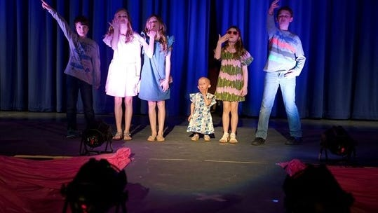 Verona's Zoey Penny, second to right, joins the fashion show at Mountain Lakes High School Sunday, March 19, 2017.