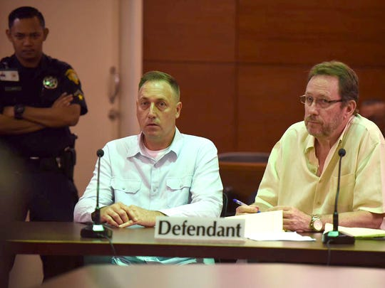 Paul John Santos, left, listens during his sentencing hearing as he sits beside his attorney, F. Randall Cunliffe, at the Superior Court of Guam in this April 26, 2017 file photo.