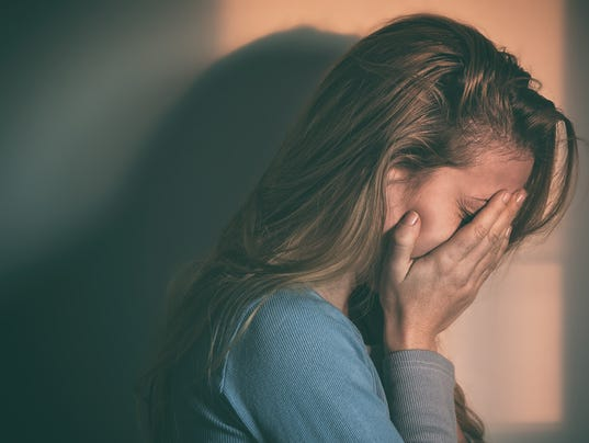 Woman sitting alone and depressed