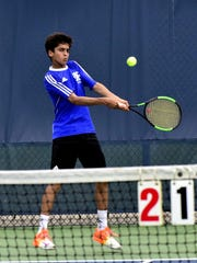 Ronit Hiryur of St. Xavier readies a two handed back hand return of service aagainst his Mason opponent. May 18, 2017