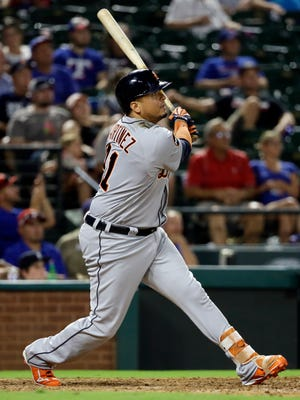 Tigers designated hitter Victor Martinez follows through on a fly out in the ninth inning of the Tigers' 6-2 loss to the Rangers on Monday, Aug. 14, 2017, in Arlington, Texas.