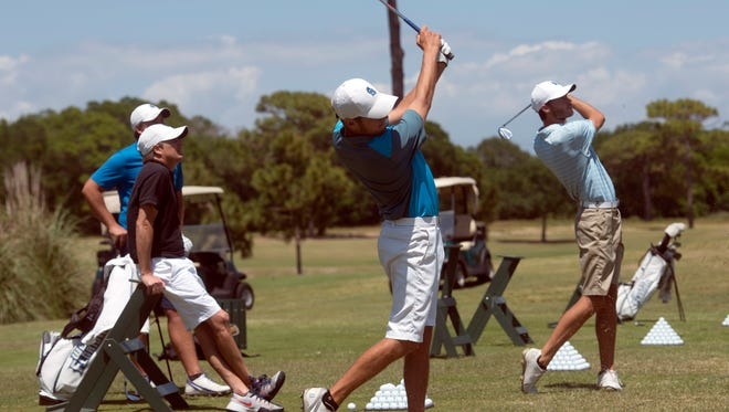 Chandler Blanchett, center, and Christian Bosso, far right, practice with their irons at Pensacola Country Club while teammate, Henry Westmoreland, lV, left, and coach Steve Fell, left center, look on Thursday afternoon April 20, 2017. The Argos are the number 1 team in the nation and heading to the Gulf South Conference Tournament on Saturday.