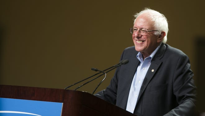 Presidential candidate Bernie Sanders pauses for a brief smile at the Phoenix Convention Center in Phoenix, AZ on July 18, 2015.