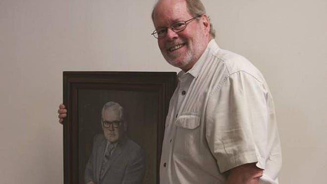 Dr. Roger Barnes, with a painting of his father Charles Barnes who was Dodge City Community College longest serving head administrator. SUBMITTED PHOTO