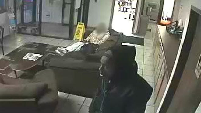 St. Cloud police released security camera photos of the Super 8 robbery.