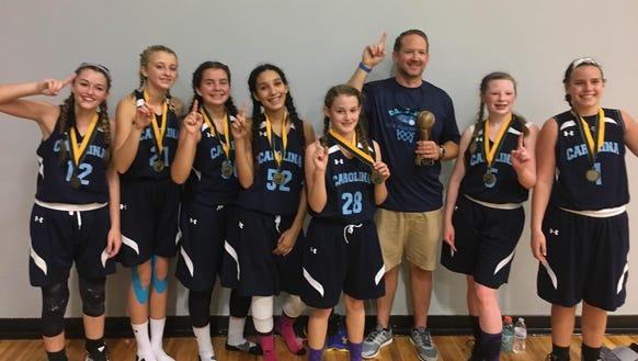 The Team Carolina Asheville 14U girls basketball team.
