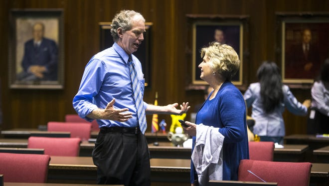 Eric Meyer and Kate Brophy McGee talk at the beginning of a special session in May 2014.