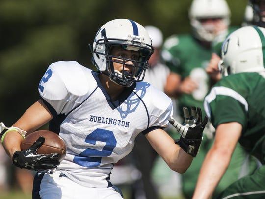 Burlington's Kevin Garrison (2) runs with the ball