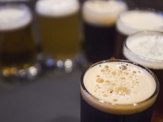 A flight of beer is served at Equinox Brewing on Thursday,