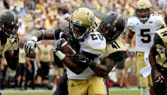Georgia Tech running back Dedrick Mills scores a rushing touchdown against Vanderbilt linebacker Zach Cunningham in the third quarter on Sept. 17, 2016.