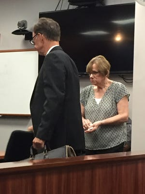 Ruthanne Finn, right, appears in 54A District Court for a preliminary hearing July 13, 2017. She reached a plea deal with prosecutors and is scheduled to be sentenced Nov. 29.