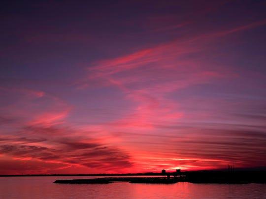 One more reason we love Pensacola, as the sunsets over Pensacola Bay Thursday, Jan. 25, 2018.