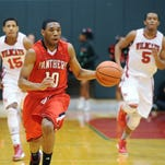 Park Tudor's Trevon Bluiett drives the ball against Perry Meridian, Jan. 8, 2013 during the first round of the Marion County boys basketball tournament.