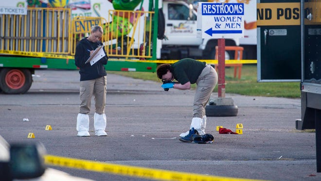 Crime scene technicians gather and process evidence at the scene of a fatal stabbing at the Champlain Valley Fair in Essex Junction on Monday, September 5, 2016. One man was killed late Sunday night and police are searching for the perpetrator.