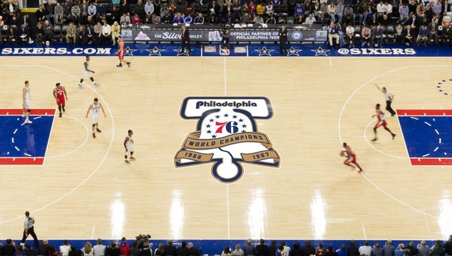 A logo commemorating the 76ers' championship team will sit at center court for six games.