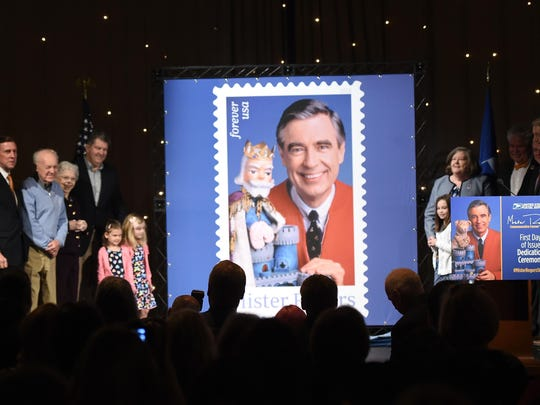 Joanne Rogers poses for a photo with other family members during the U.S. Postal Service Dedication of the Mister Rogers Forever Stamp at WQED's Fred Rogers Studio on March 23, 2018 in Pittsburgh, Pennsylvani