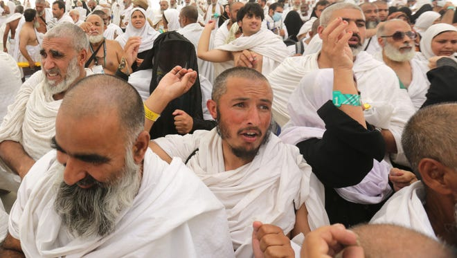 Muslim pilgrims throw stones at a symbolic devil while reciting prayers, hours after a stampede had taken place in Mina, near Mecca, Saudi Arabia, 24 September 2015.