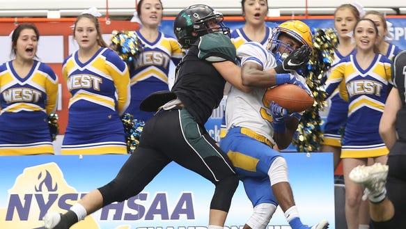 West Seneca West's Juston Johnson (5) catches a pass