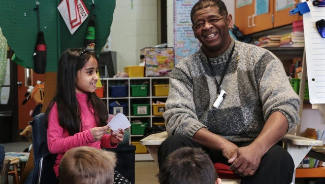 James Robertson, 56, of Detroit reacts to a question asked by Barnard Elementary School second-grader Siri Hebbar on Wednesday.
