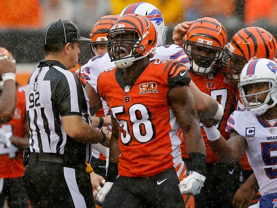 Cincinnati Bengals defensive end Carl Lawson (58) cheers after Buffalo Bills quarterback Tyrod Taylor (5) does down for a loss in the first quarter of the NFL Week 5 game between the Cincinnati Bengals and the Buffalo Bills at Paul Brown Stadium in downtown Cincinnati on Sunday, Oct. 8, 2017.