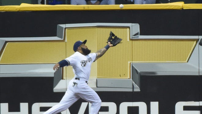 Brewers leftfielder Eric Thames is unable to chase down a deep drive off the bat of the Pirates' Jordan Luplow during the fourth inning at Miller Park.